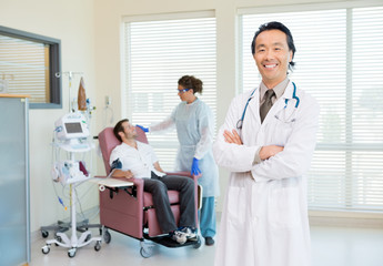Doctor With Patient Being Examined By Heartbeat Machine