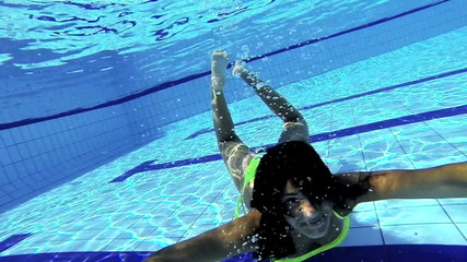 Happy woman playing underwater slow motion
