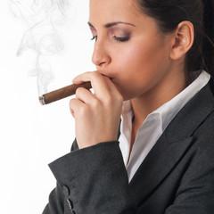 Woman smoking cigar. Studio fashion photo on white background.