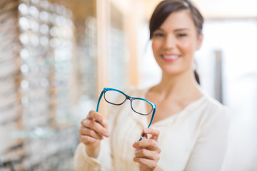 Woman Showing Glasses At Store