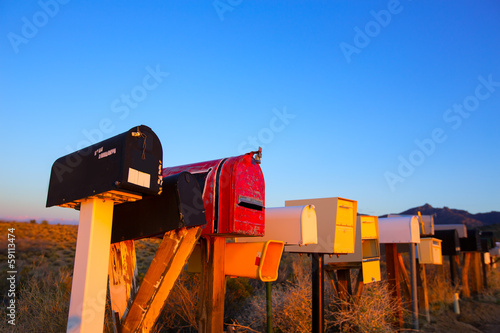 Grunge mail boxes in a row at Arizona desert