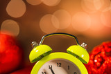 Alarm clock and Christmas ornaments with light blur background