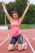Toned young woman cheering on the running track