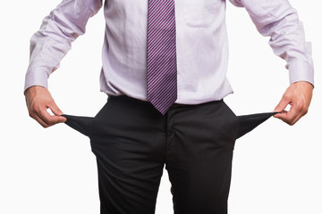Mid section of a businessman with pockets pulled out