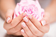 Obrazy na płótnie, fototapety, zdjęcia, fotoobrazy drukowane : Beautiful woman's nails with french manicure  and rose