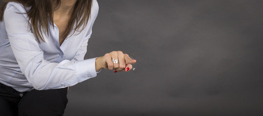Business woman pointing her finger on imaginery virtual button