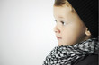 fashionable little boy in scarf and cap.winter children