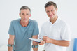 Male therapist and disabled patient with reports