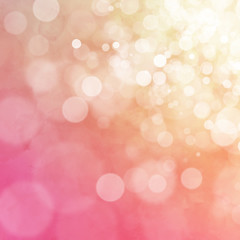White bokeh on orange and pink watercolor background