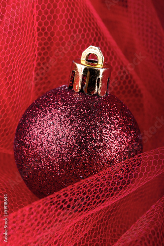 christmas ball on a red silk cloth