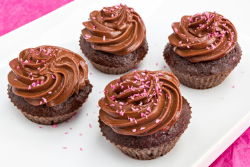 Chocolate cupcakes with pink coconut sprinkles