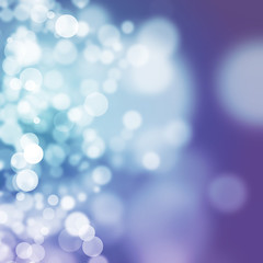 White bokeh on smooth blue and purple background