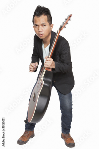 Entertainment Asian handsome musician playing guitar