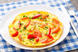 Omelet with paprika, tomato and herbs