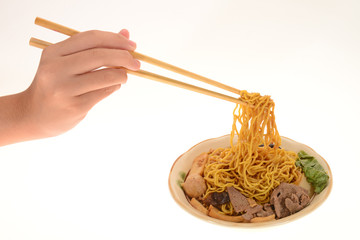 Using  Chopsticks To Eat From A Bowl Of Noodles