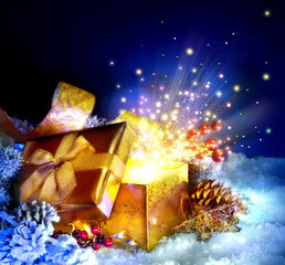 Christmas Gift Box with miracle. Magic Stars and Light