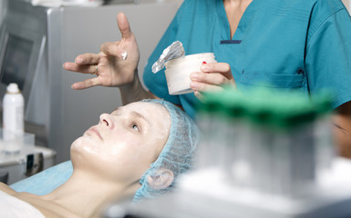 Woman being prepped in a skincare clinic