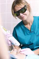 Smiling practitioner doing a laser treatment