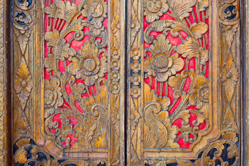 Indian inspired carved golden red wooden door