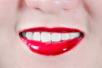 Woman lips with makeup smiling