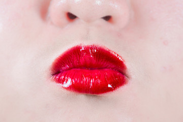 Woman lips blowing a kiss