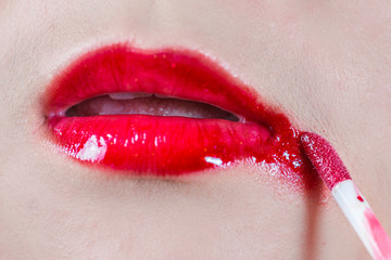 Lips with smeared lipsticks