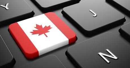 Canada - Flag on Button of Black Keyboard.