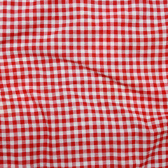 Abstract background texture of a red and white textile