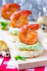 Shrimp on toast with guacamole sauce avocado, Christmas tasty