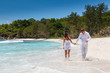 Young couple married laying on sandy beach