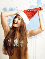 funny cheerful girl in red hat and bikini celebrating