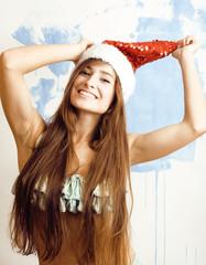 funny cheerful girl in red hat and bikini celebrating