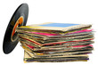 45 rpm vinyl discs stack on white background
