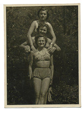 Three girls on summer break  in bathing suits  - circa 1945