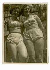 two girls on summer break  in bathing suits  - circa 1945