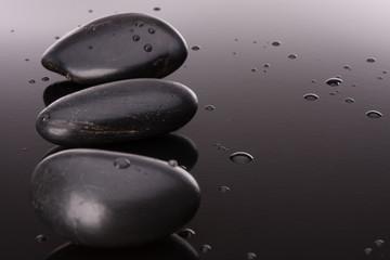 Spa stone arrangement on black surface. Healthcare concept.