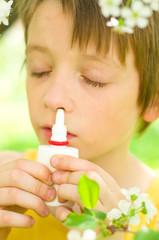 child spraying his nose