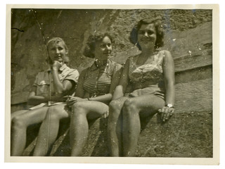 three girls on summer break (in bathing suits) - circa 1950