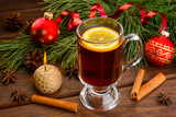 mulled wine with anise on wood background