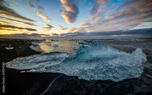 Black Beach with Icebergs at sunrise, Jokulsarlon Lake, Iceland