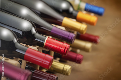 wine bottles stacked  with very limited depth of field