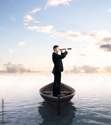 businessman with telescope