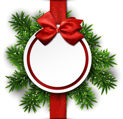 White round paper christmas card with bow.