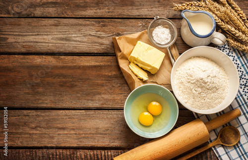 Fotobehang Koken Dough recipe ingredients on vintage rural wood kitchen table