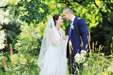 Beautiful wedding couple. Outdoors portrait
