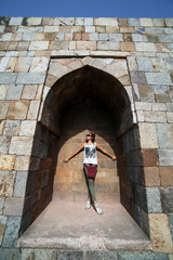 Caucasian tourist girl at Qutb Minar, New Delhi