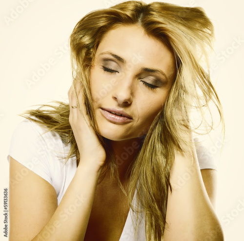 Attractive young blonde woman closed eyes portrait