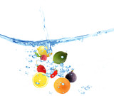 Fresh fruits dropped into water