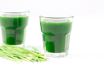 Wheat grass juice on white background