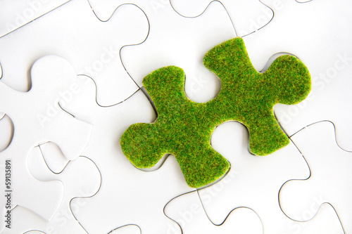 green puzzle piece, green space concept
